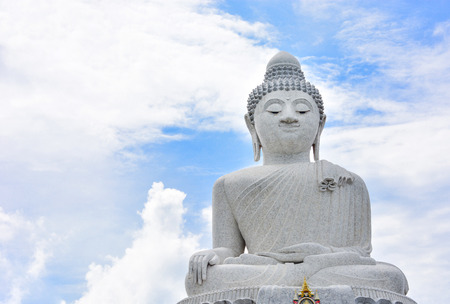 big white marble buddha isolated on cloudy and blue sky background, copy space, Phuket, Thailand