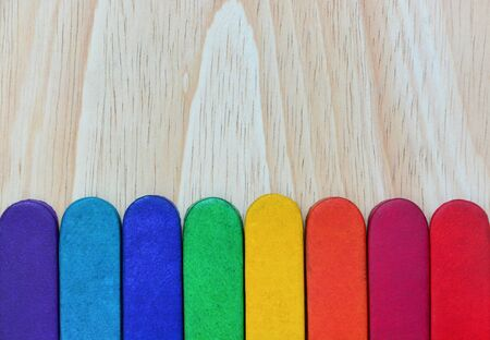 rainbow colors leather texture on wood background, copy space