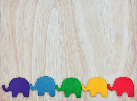 rainbow colors leather texture in elephant shape on wood background, copy space