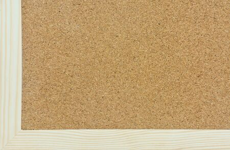 the corner of cork board with pine wood frame