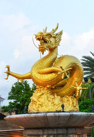gold dragon sculpture at public park, Phuket Thailand