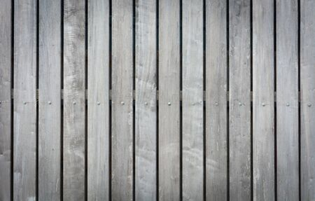background texture of old wood fence, raw wood fence. vertical planks