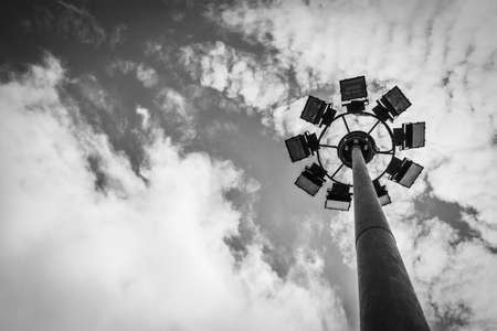 sport light post (street lamp pole) with cloud and sky background in greyscale tone Banque d'images