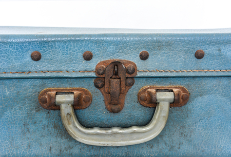 old handle and lock of blue vintage bag suitcase isolated on white background