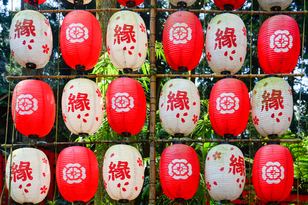 string of red and white color decorative traditional Japanese paper lanterns written as edge in Chinese language