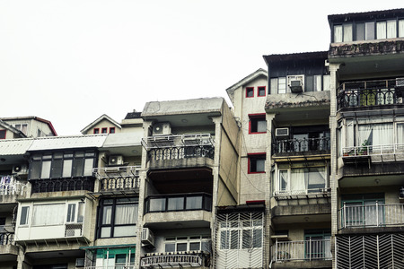 a row of old townhouse, old crowded vintage residential tenement house building in Taipei, Taiwan, isolated on white background, copy space