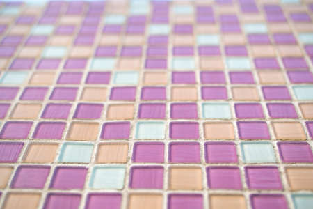 Closeup of pink swimming pool tiles photo