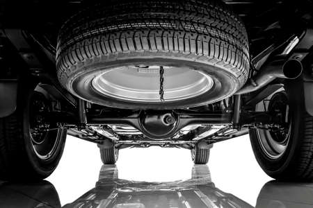 Car suspension, chassis and spare tire on black and white tone Stock Photo