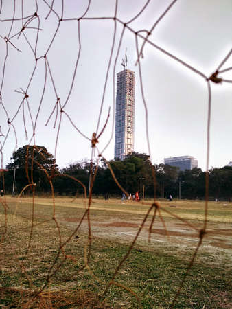 This picture is of the tallest building in Kolkata namely known as 'The 42'. A click from the meadow located beside this building Stock Photo - 94383737