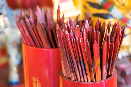 chien: Red bamboo stick for shaking, ancient chinese fortune telling call Kau Cim, Chien tung fortune sticks or Guan Yin sticks Stock Photo
