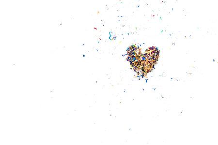 heartbreaking: Colorful Pencil Shaving arrange to heart shape on white desk
