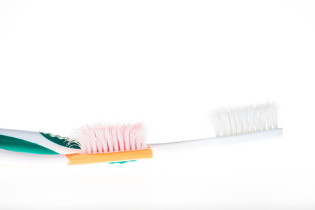 Two Color worn toothbrush on white