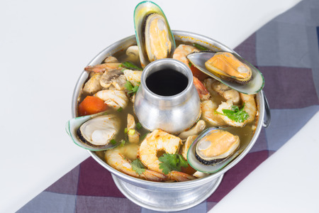 Po-Tak Spicy Sour Seafood Soup contains shrimp, Squid, Basa Fillets, Mussel, Crab claws, Gingers, Lemongrass, Kaffir Lime leaf and Cilantro photo