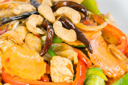 Pad cashew nut with chicken sauteed, white onions, green onions, carrots, dried chili photo