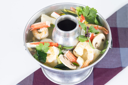 Po-Tak Spicy Sour Seafood Soup contains shrimp, Basa Fillets, Mussel, Crab claws, Gingers, Lemongrass, Kaffir Lime leaf and Cilantro photo