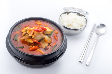 kimchi stew, kimchi chigae, korean cuisine, kimchi soup with steam rice, spoon and chopsticks isolated on white background