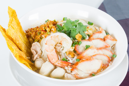 Combination Noodle contains many thai food, stir fried silver noodle, shrimp, fish ball, fish cake, BBQ pork, chicken, bean sprouts, green onions, cilantro, crushed peanuts, dried chili, garlic and crispy wonton skin photo