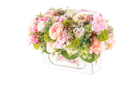 Decoration artificial plastic flower with vintage design basket isolated on white background photo