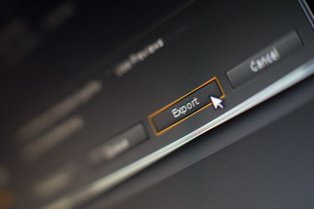 Mouse pointer clicking on a export button in editing software, macro shot