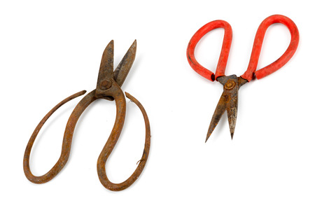 snips: old scissors full of rust isolated on white background