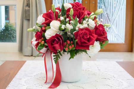 Roses Flowers Bouquet Inside Vase On Desk In House For Decoration