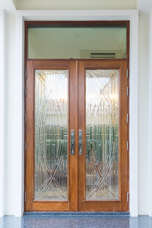 view of a wooden doorway: Front door of exclusive expensive house decorate with wood and garnite floor