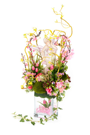 Decoration artificial plastic flower with vintage design vase isolated on white background photo