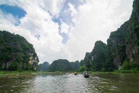 tam: Tam Coc, Ninh Binh, Vietnam - September 14, 2014. Tour tourist boats in bay