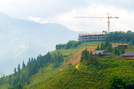 Construction crane building on hilltop that have beautiful view photo