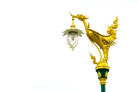 Electric pole with golden thai traditional swan on top isolated on white background photo