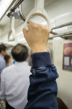 hand rail: Hand of passengers hold on rail handle of transit system, train