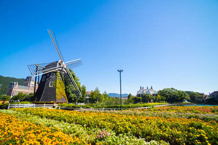 japan sky: Windmill at Huis Ten Bosch stand in a bright and clear sky, Japan