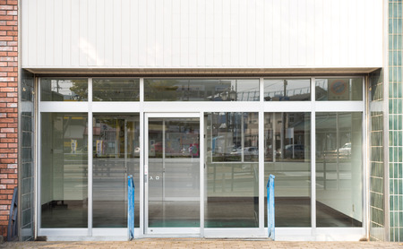 Empty shops waiting for someone to rent or buy Banco de Imagens