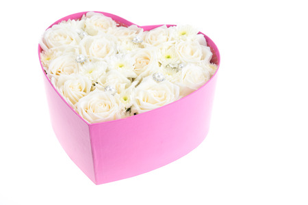 White roses and pearl and diamond held in the heart shape box. gift for valentine photo