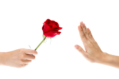 refused: Hand Refused the gift, When hand of sender give flower to recipient that making hand signals to decline, isolated on white background Stock Photo