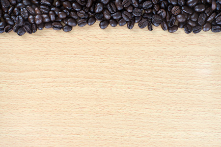 Coffee bean on wood background with space for text Banco de Imagens