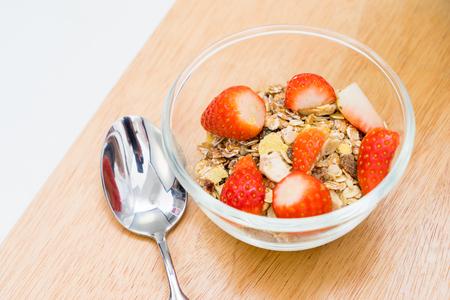 Breakfast, fresh strawberries in cereal bowl Banco de Imagens