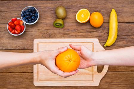 Fresh, Ripe, Various fruit, Hand give and take orange
