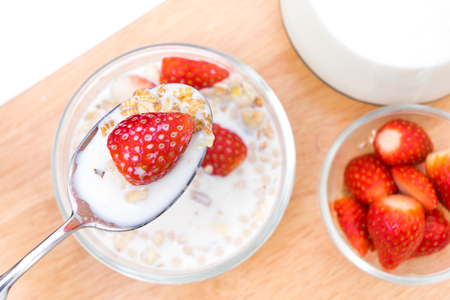Breakfast, eating cereal, pick up spoon, scoop cereal with strawberries, ready to eat , Top shot