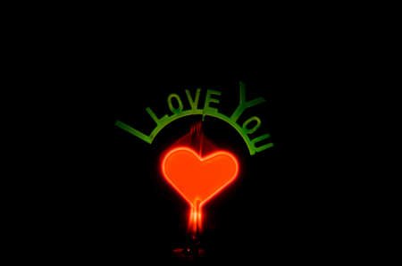 romatic: i love you and light heart on black blackground