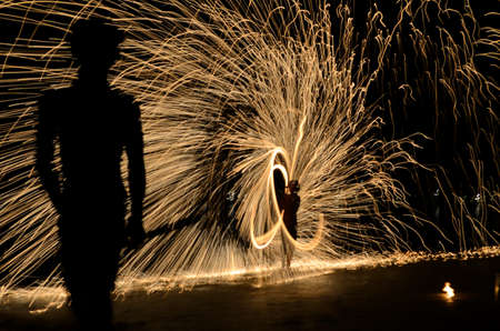Show spinning fire rod by a boy at samed island, THAILAND