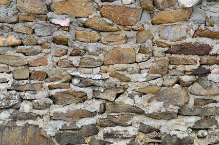 stone wall on the beach photo