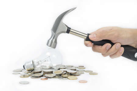 lost money: lost money too much with incandescent lamp, so change it like a hammer smash to get your money back Stock Photo