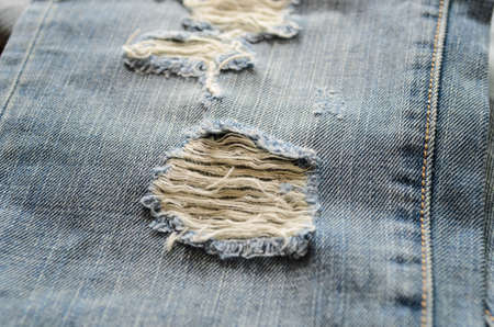 lacking: old jeans with lacking Stock Photo