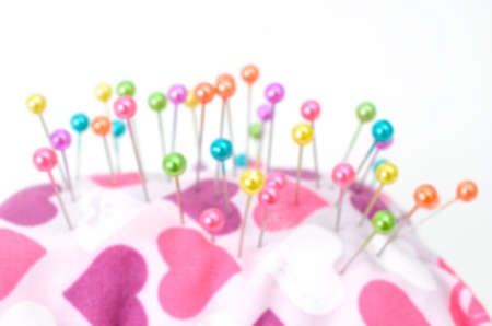 pinhead: blur pinhead on the pincushion background Stock Photo