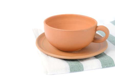 empty baked clay coffee cup on white background