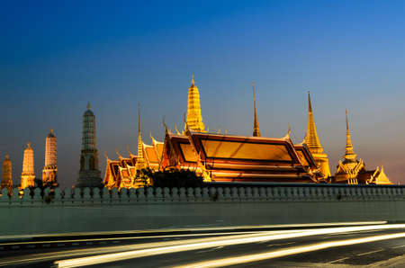 golden palace in the evening with moving car light , Bangkok Thailand