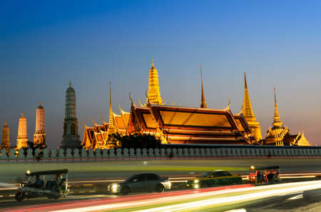 Wat phra kaeo, THAILAND - JANUARY 2, 2015: Golden palace in the night time with local taxi and Tuktuk, Thailand