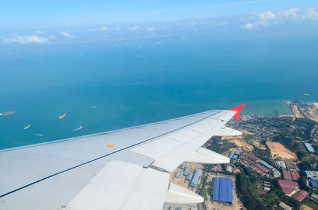 view from aircraft when turning above harbour, singapore
