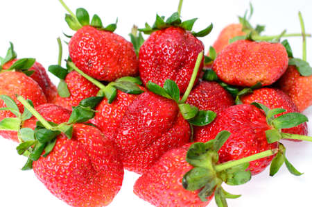 strawberries and green stem on white background